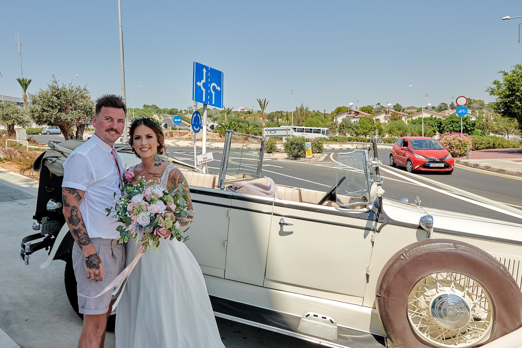 The elegant bohemian wedding of Abbie & Lee.  Getting ready shots at Napa suites in, Ayia Napa, and Villa Cynthia in Protaras.  The wedding  ceremony held at Sirens beach in Ayia Thekla and the wedding reception at.  Polyxenia Isaak in Protaras.  We had an on loaction trip out to Cape Greco and Blood Brothers tattoo parlour in Ayia Napa..  Wedding photograpy in Cyprus by Richard King  http://www.thecyprusweddingphotographer.com